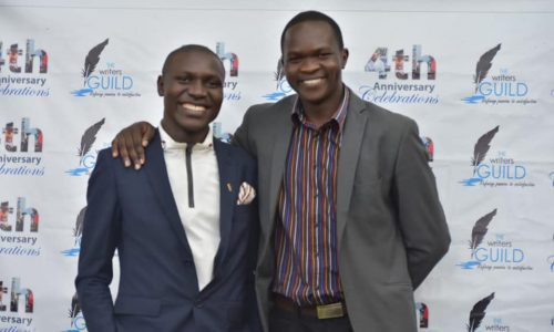Dekker William(left)Poses for a photo with Gabriel Dinda, Founder of Writers Guild Kenya at the 4th Anniversary Celebrations of WGK